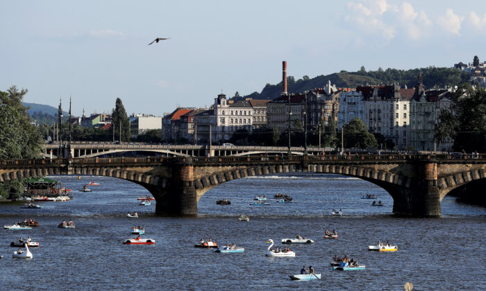 People ride pedal boats on the Vltava River following the coronavirus disease (COVID-19) outbreak, in Prague, Czech Republic, on June 22, 2020. (David W Cerny/Reuters)