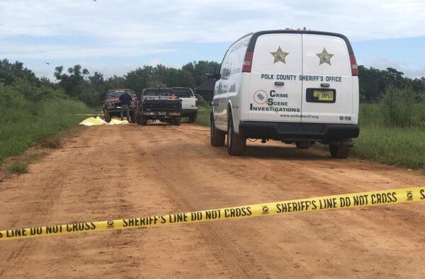 Police investigate a triple homicide