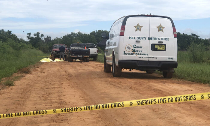 Police investigate a triple homicide near Lake Streety, Fla., on July 18, 2020. (Courtesy of Polk County Sheriff's Office)