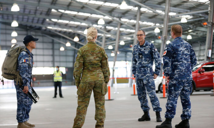 ADF (Australian Defence Force) personnel assist with a COVID-19 testing at Melbourne Showgrounds on June 29, 2020 in Melbourne, Australia. (Darrian Traynor/Getty Images)