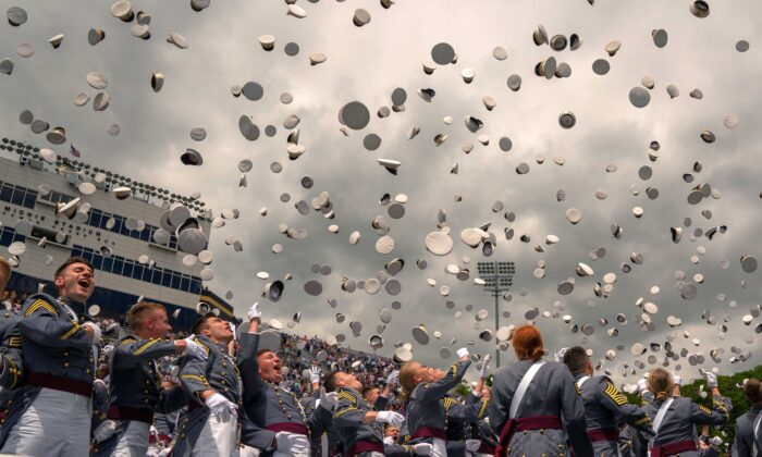 West Point graduates toss their hats in the air at the conclusion of the U.S. Military Academy Class of 2019 graduation ceremony at Michie Stadium, in West Point, N.Y., on May 25, 2019. (David Dee Delgado/Getty Images)