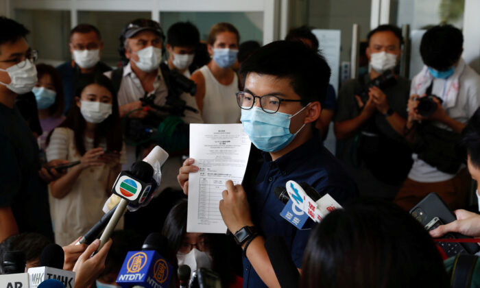 Pro-democracy activist Joshua Wong registers as a candidate for the upcoming Legislative Council election in Hong Kong on July 20, 2020. (Tyrone Siu/Reuters)