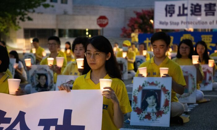 Falun Gong practitioners hold a vigil to commemorate the 21st anniversary of the Chinese regime's persecution of Falun Gong, in Washington, on July 17, 2020. (Lynn Lin/The Epoch Times)