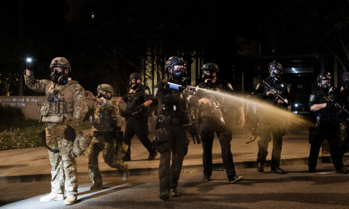 Federal officers respond to violent protests outside the Multnomah County Justice Center in Portland, Ore., on July 17, 2020. (Mason Trinca/Getty Images)