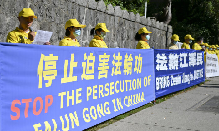 Falun Gong practitioners hold a rally to commemorate the 21st anniversary of the persecution of Falun Gong, in Vancouver, Canada, on July 19, 2020. (Da Yu/The Epoch Times)