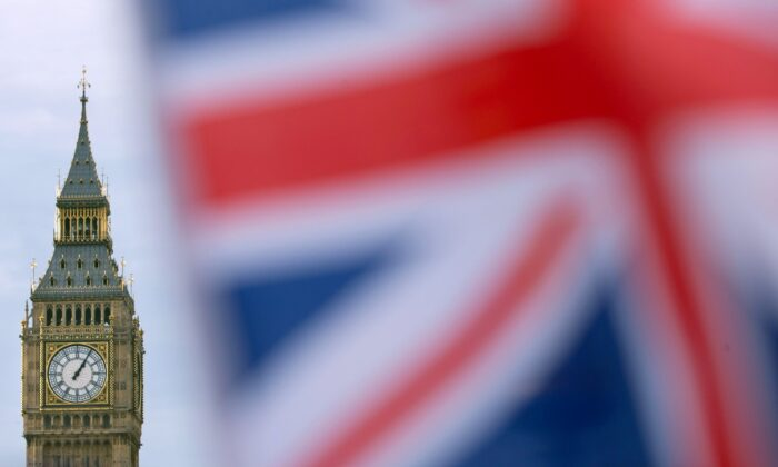 A British Union flag flies near the Elizabeth Tower, otherwise known as Big Ben, opposite the Houses of Parliament in central London, England, on Dec. 7, 2016. (Daniel Leal-Olivas/AFP via Getty Images)