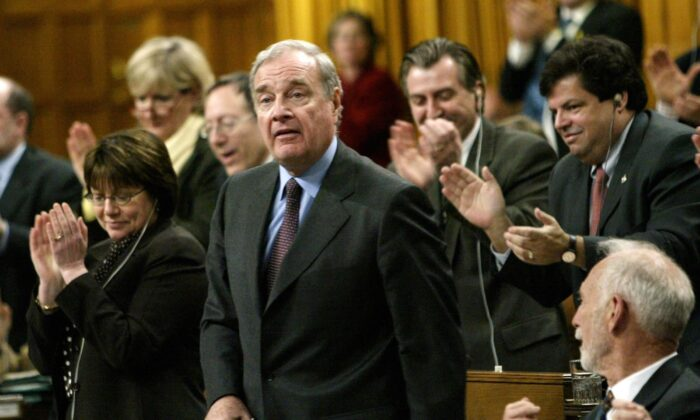 Prime Minister Paul Martin receives a standing ovation after responding to questions concerning the sponsorship scandal in the House of Commons on April 20, 2004. The scandal became a significant factor in the defeat of the Liberals in the 2006 federal election after more than 12 years in power. (CP Photo/Tom Hanson)