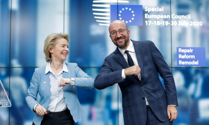 European Council President Charles Michel and European Commission President Ursula Von Der Leyen do an elbow bump at the end of a news conference following a four-day European summit at the European Council in Brussels, Belgium, on July 21, 2020. (Stephanie Lecocq/Pool via Reuters)