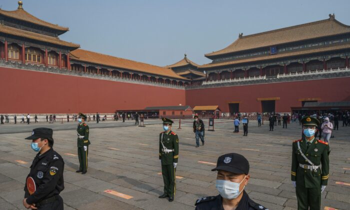 Chinese paramilitary police and guards stand in front of the entrance to the Forbidden City in Beijing on May 1, 2020.   (Kevin Frayer/Getty Images)
