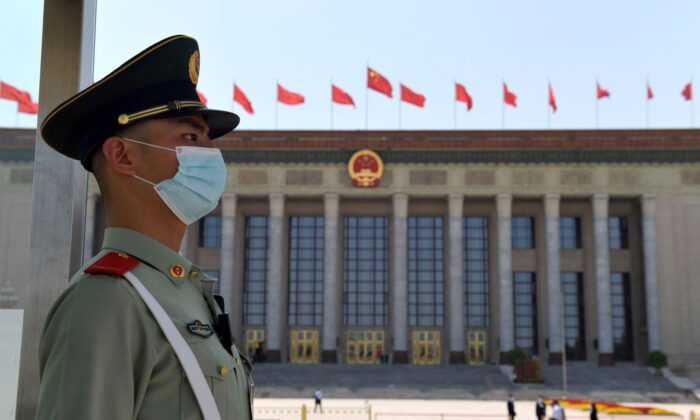 A paramilitary policeman stands guard outside the Great Hall of the People ahead of the closing session of the National People's Congress in Beijing on May 28, 2020. (Nicolas Asfouri/AFP via Getty Images)