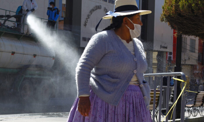Amid the COVID-19 pandemic, municipal workers disinfect the main streets of Puno, in the highlands of Peru close to the border with Bolivia, on July 17, 2020. (CARLOS MAMANI/AFP via Getty Images)