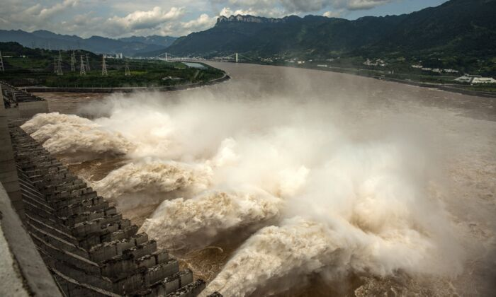 The Three Gorges Dam is discharging flood water in Yichang, China, on July 19, 2020. (AFP via Getty Images)