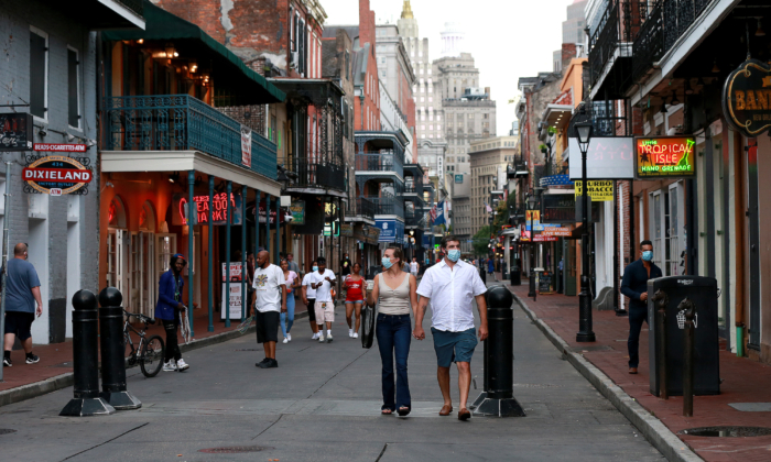 Pedestrians are seen walking along Bourbon Street in the French Quarter in New Orleans, Louisiana, on July 14, 2020. (Sean Gardner/Getty Images)