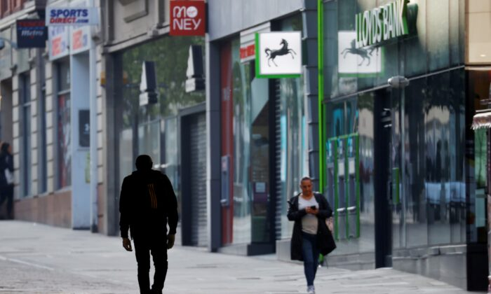 People are seen walking on a street in Manchester, following the outbreak of the coronavirus disease (COVID-19), in Manchester, Britain, on May 4, 2020. (Phil Noble/Reuters)