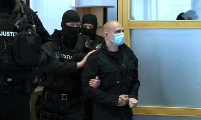 Stephan Balliet, who is accused of shooting two people after an attempt to storm a synagogue in Halle, arrives into the courtroom for the start of his trial, at the district court in Magdeburg, Germany July 21, 2020. (Ronny Hartmann/Pool via Reuters)