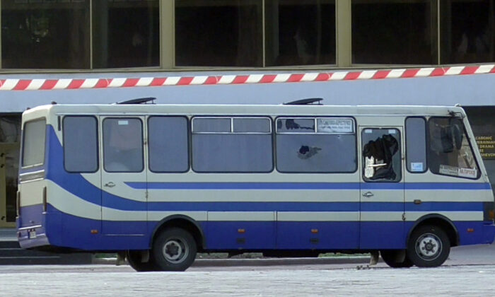 A bus with people held hostage after an armed man seized a bus and took some 10 people hostage in the city center of Lutsk, west of Kyiv, Ukraine, on July 21, 2020. (Ukrainian Police Press Office via AP)