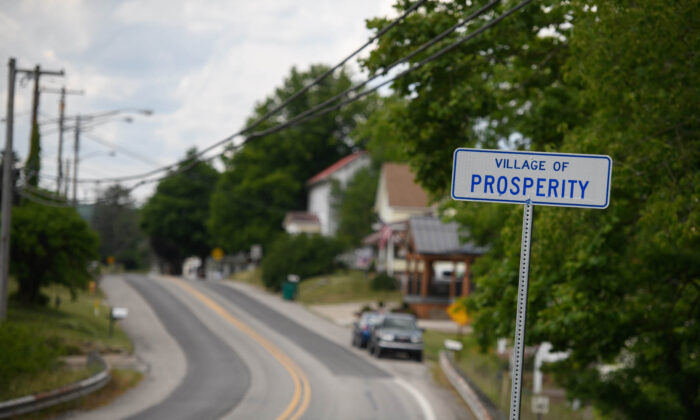 The sign for the village of Prosperity sits along state Route 18. (Justin Merriman)
