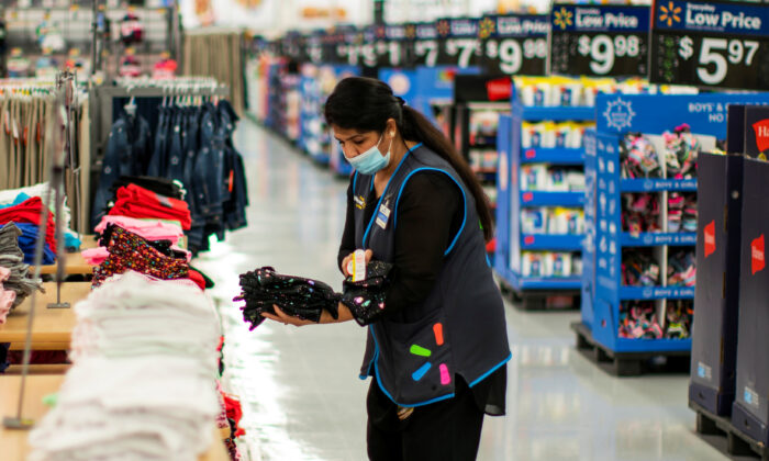 A worker wears a mask while organizing merchandise at a Walmart store, in North Brunswick, N.J., on July 20, 2020. (Eduardo Munoz/Reuters)