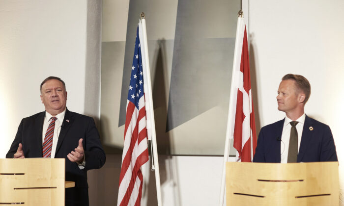 Danish Foreign Minister Jeppe Kofod, right and U.S. Secretary of State Mike Pompeo give a joint press conference in Copenhagen, Denmark, Wed., July 22, 2020.  (Thibault Savary/Pool Photo via AP)
