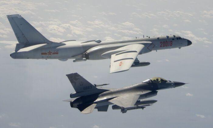 A Taiwanese Air Force F-16 in foreground flies on the flank of a Chinese People's Liberation Army Air Force (PLAAF) H-6 bomber as it passes near Taiwan, on Feb. 10, 2020. (Republic of China (ROC) Ministry of National Defense via AP)