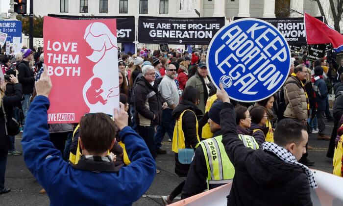 Pro-choice and pro-life activists demonstrate in front of the the US Supreme Court during the 47th annual March for Life in Washington on Jan. 24, 2020. (Olivier Douliery/AFP via Getty Images)