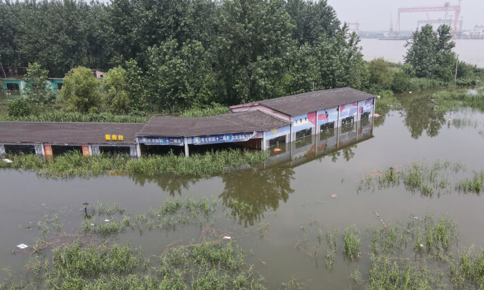 A building is inundated by flood in Zhenjiang, China, on July 20, 2020. (STR/AFP via Getty Images)