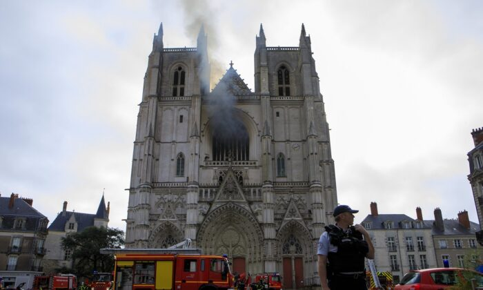 A fire fighters brigade works to extinguish the blaze at the Gothic St. Peter and St. Paul Cathedral, in Nantes, western France, on July 18, 2020. (Laetitia Notarianni/AP Photo)