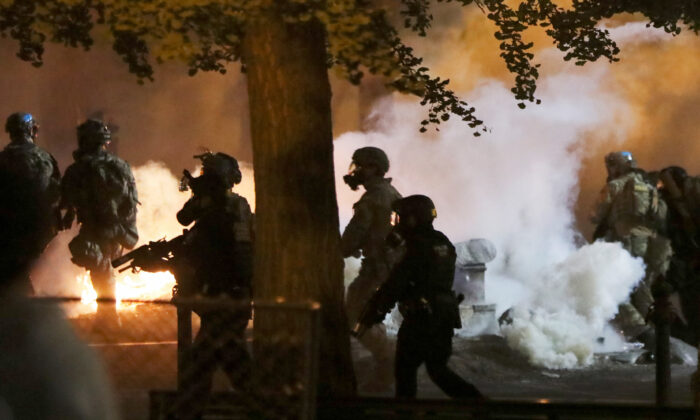 Federal law enforcement officers face off with rioters  in Portland, Ore., on July 21, 2020. (Caitlin Ochs/Reuters)