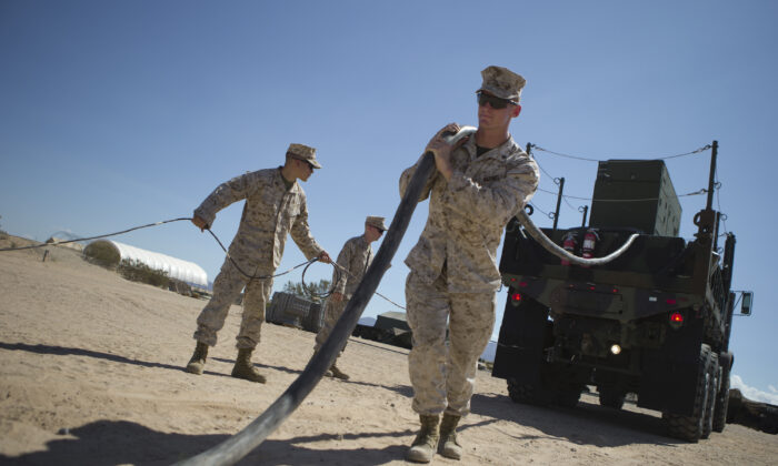 U.S. Marine Corps Cpl. Hunter, Jake, a radar technician, pulls the generator power cable to the Ground/Air Task Oriental Radar (G/ATOR) on Sept. 16, 2015 at Cannon Air Defense Complex (P111), Yuma, Ariz. (U.S. Marine Corps photo by Cpl. Summer Dowding MAWTS-1 COMCAM/ Released)