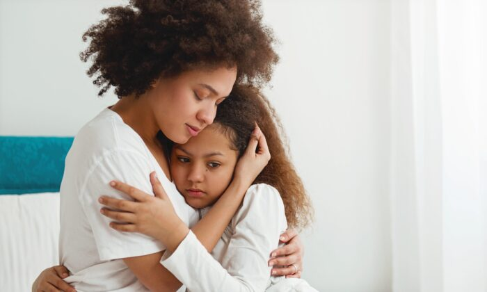It is normal for parents to grieve the loss of a loved one. Doing so shows children how loss can affect us, and how to move through it. (TijanaM/shutterstock)