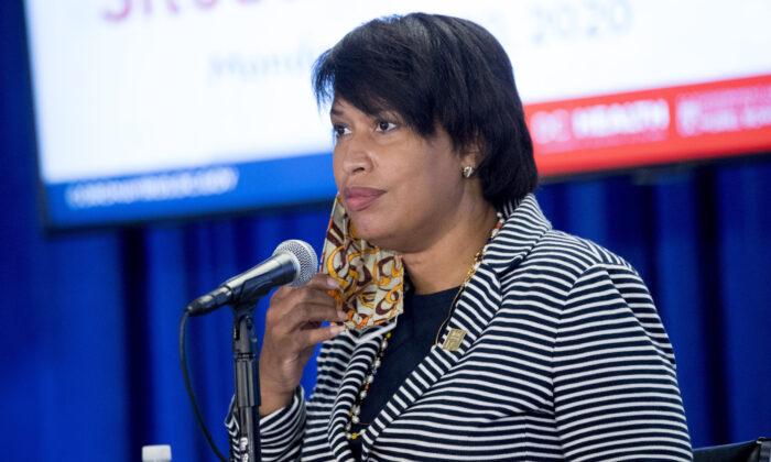 Washington Mayor Muriel Bowser takes off her mask as she arrives at a news conference on the coronavirus and the District's response in Washington on July 20, 2020. (Andrew Harnik/AP Photo)
