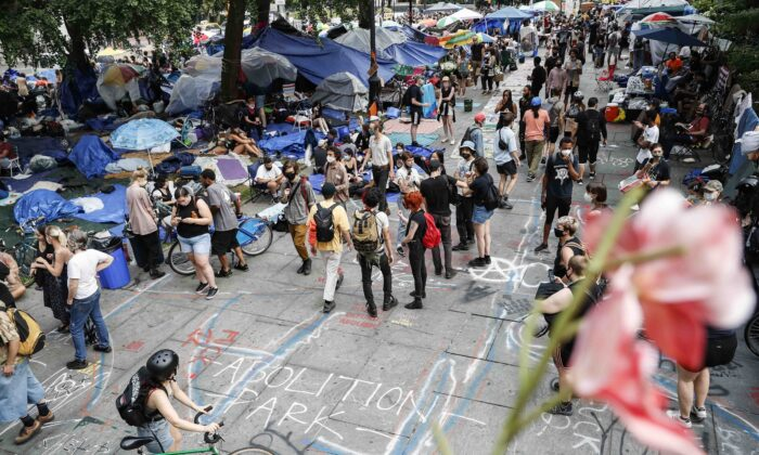 Protesters gather at an encampment outside City Hall in New York City on June 30, 2020. (John Minchillo/AP Photo)