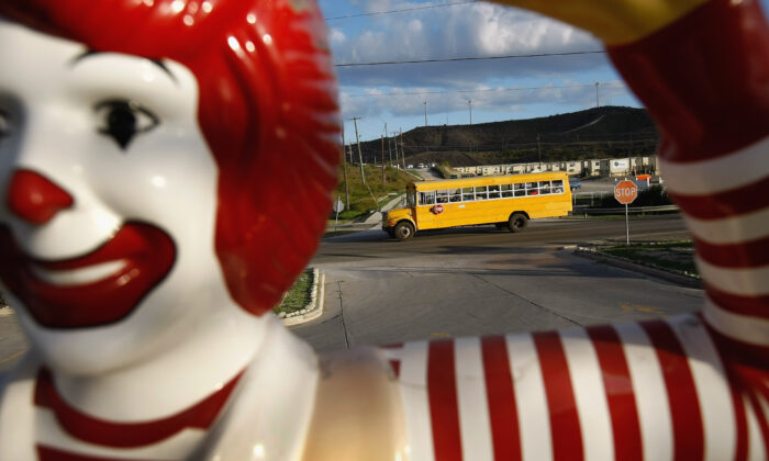 A school bus passes a McDonald's at the U.S. Naval Base at Guantanamo Bay, Cuba, in a file photograph. (John Moore/Getty Images)