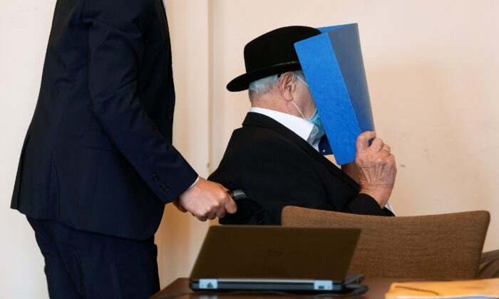 The 93-year-old German Bruno D. accused of being an SS guard involved in killings of thousands of prisoners, many of them Jewish, between August 1944 and April 1945, in the Stutthof Nazi concentration camp near Gdansk, Poland, arrives for expecting his verdict in his trial, in a Hamburg court room, Germany, on July 23, 2020. (Fabian Bimmer/Pool/Reuters)
