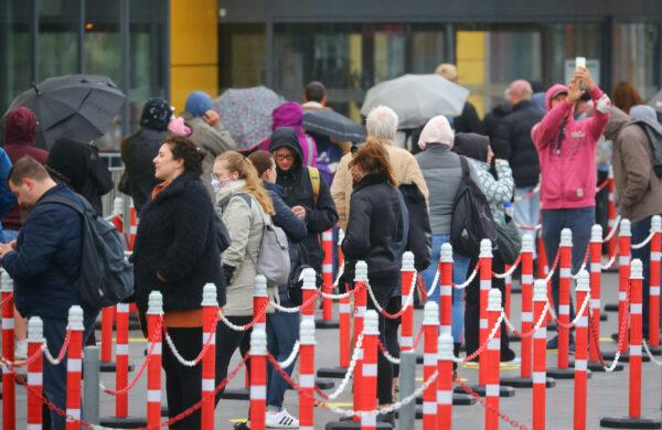 Customers wait outside an IKEA shop