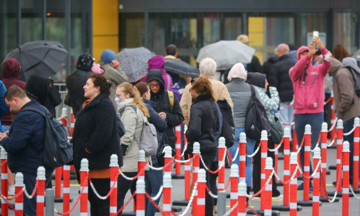 Customers wait outside an IKEA shop after the coronavirus disease (COVID-19) lockdown has been eased around the country and the company opens some of its stores, in Berlin, Germany, on May 11, 2020. (Hannibal Hanschke/Reuters)