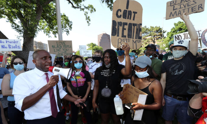 Kansas City Mayor Quinton Lucas addresses demonstrators with a bullhorn during a protest at the Country Club Plaza on May 31, 2020 in Kansas City, Missouri.  (Photo by Jamie Squire/Getty Images)