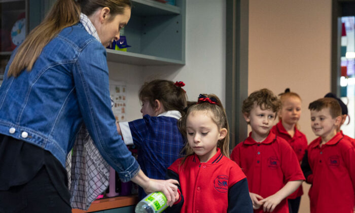 Students sanitize at Lysterfield Primary School on May 26, 2020 in Melbourne, Australia. (Daniel Pockett/Getty Images)