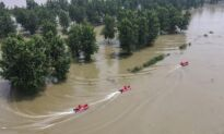 Thousands Trapped as Chinese Authorities Discharge Stormwaters Into Villages, Submerging Them