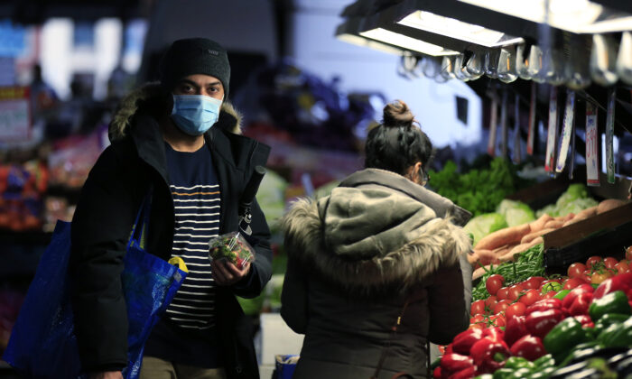 People are seen wearing face masks while shopping at the Queen Victoria Market in Melbourne, Australia on July 11, 2020. (Darrian Traynor/Getty Images)