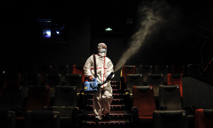 An employee disinfects a cinema in Wuhan, China, on July 20, 2020. (Getty Images)