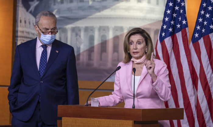 Speaker of the House Nancy Pelosi (D-CA) speaks as Senate Minority Leader Chuck Schumer (D-NY) listens during a press briefing in Washington on July 23, 2020. (Tasos Katopodis/Getty Images)