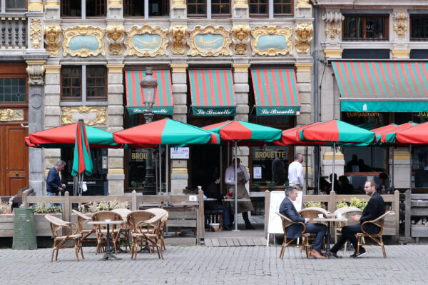 People sit on a terrace as restaurants and bars Brussels