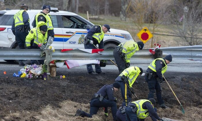 RCMP investigators search for evidence at the location where Const. Heidi Stevenson was killed along the highway in Shubenacadie, Nova Scotia, Canada, on  April 23, 2020. (Andrew Vaughan/The Canadian Press)