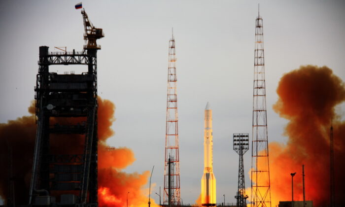 Russia's Proton rocket, carrying the Kosmos military satellite, blasts off a launch pad at Kazakhstan's Baikonur cosmodrome on March 30, 2012. (STR/AFP via Getty Images)