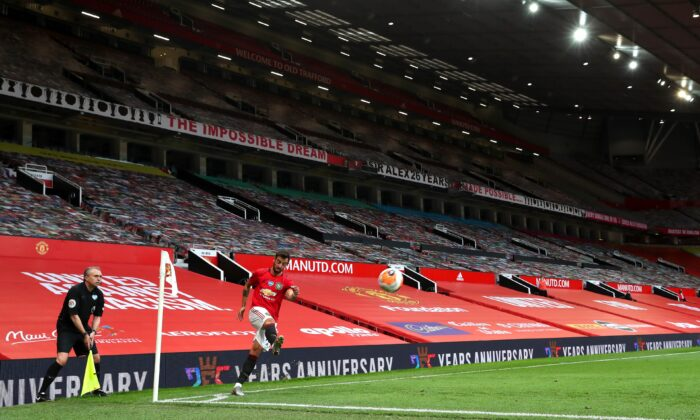 Bruno Fernandes of Manchester United takes a corner kick during the Premier League match between Manchester United and West Ham United at Old Trafford in Manchester, England, on July 22, 2020. (Catherine Ivill/Getty Images)