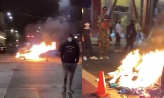 In these still images from video, rioters in Seattle set a fire with items they looted from nearby businesses, early July 23, 2020. (Katie Daviscourt via The Epoch Times)