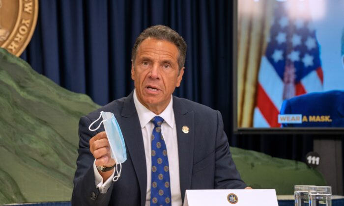 New York Gov. Andrew Cuomo holds a mask during a briefing in New York City, on July 6, 2020. (David Dee Delgado/Getty Images)