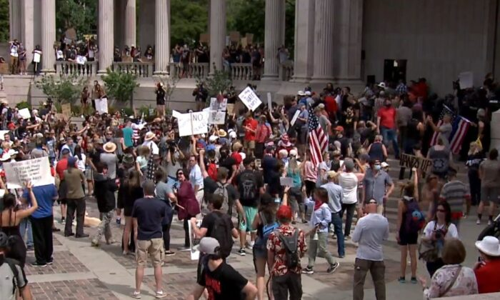 A pro-police rally in Denver, Colo., on July 20, 2020. Police were given a stand-down order, the police union chief said, and didn't intervene when rallygoers were attacked by counter-demonstrators. (KDVR)