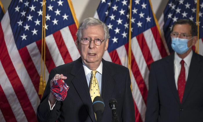 Senate Majority Leader Mitch McConnell (R-Ky.) speaks to the media after weekly policy luncheons on Capitol Hill in Washington on July 21, 2020. (Tasos Katopodis/Getty Images)